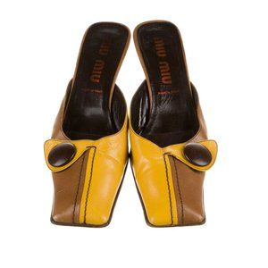 Miu Miu Yellow and brown leather mules w/ button